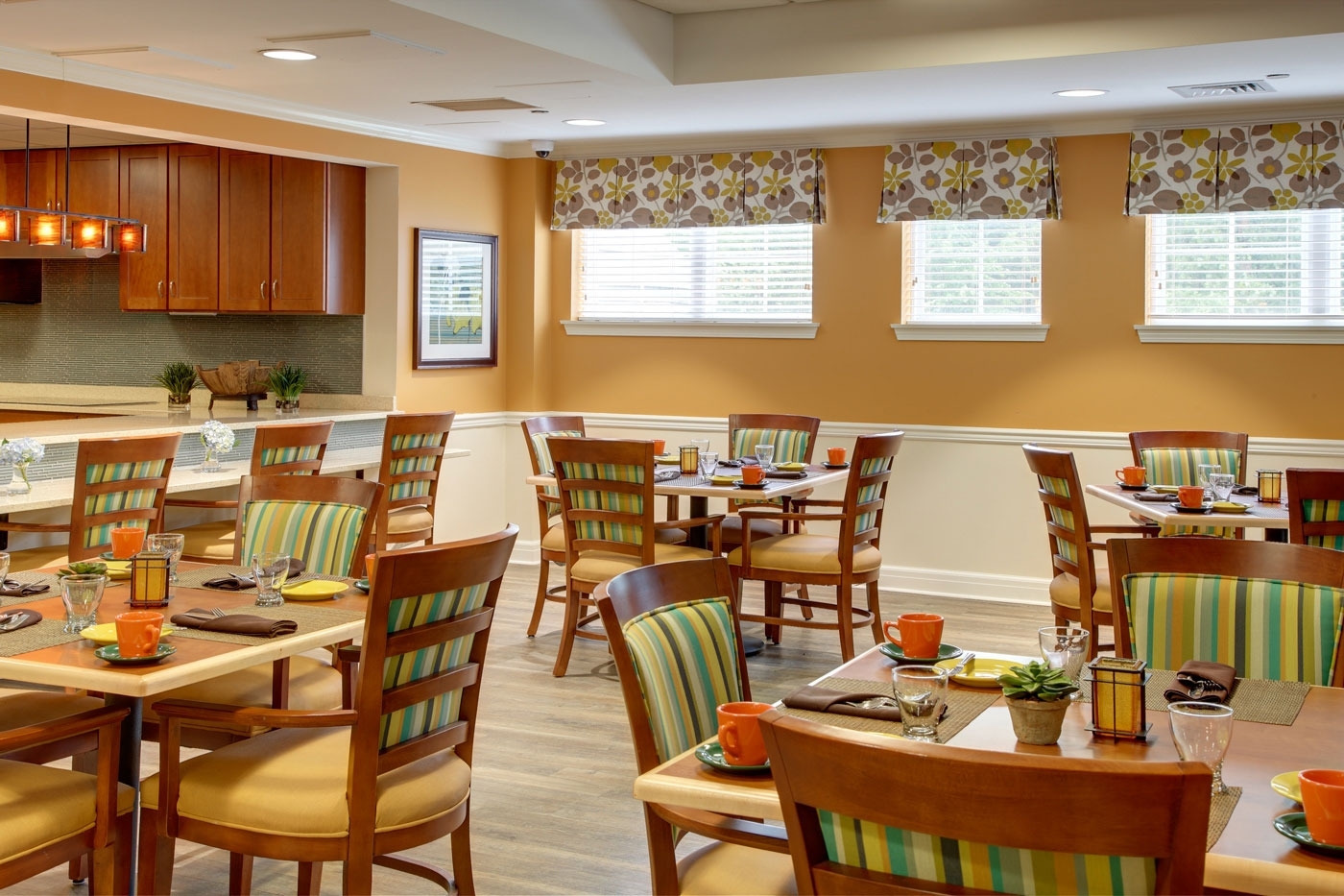 Our bright and cheerful interior design for a dining area inside an assisted living/memory care community.