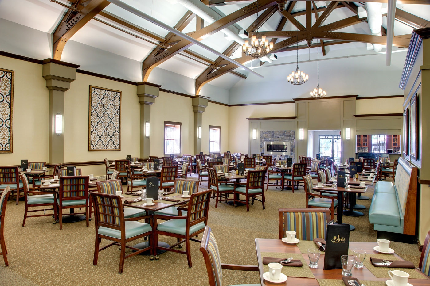 This dining room in a memory care community provides a bright and spacious area to gather.