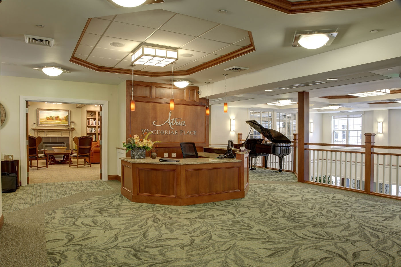 Showcasing our interior design skills of a spacious, inviting second floor entertainment area in an assisted living/memory care community