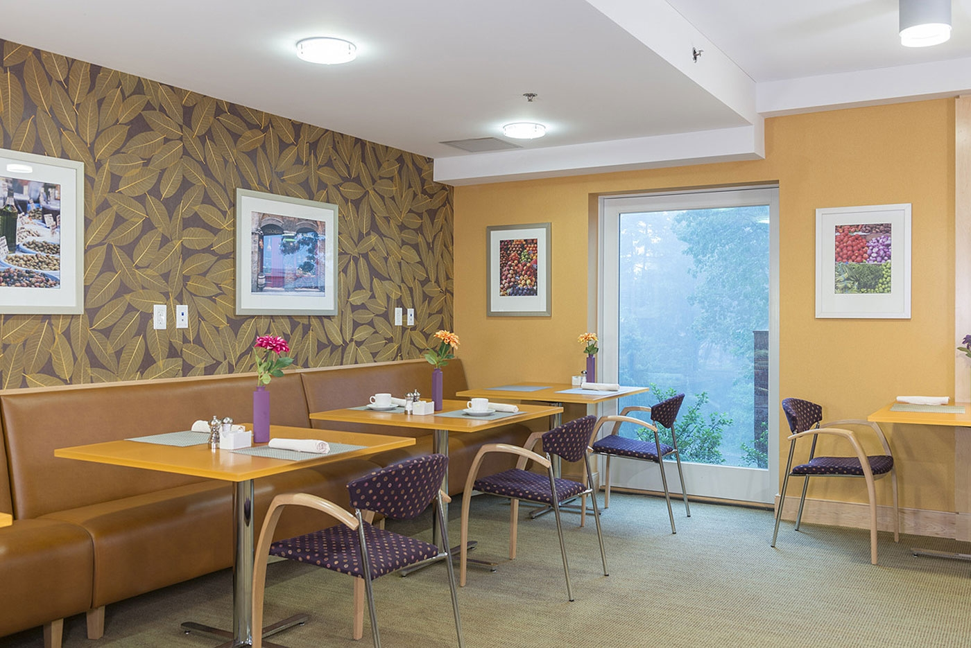 Cozy corner for smaller group socializing in a CCRC community dining area