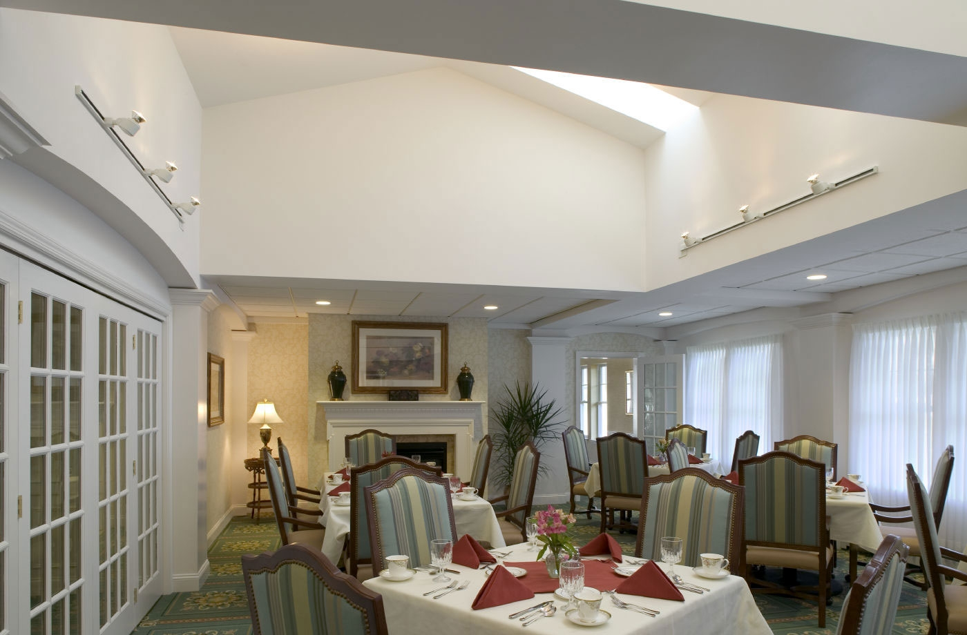 Sunshine from the skylight brightens this dining area designed for active seniors