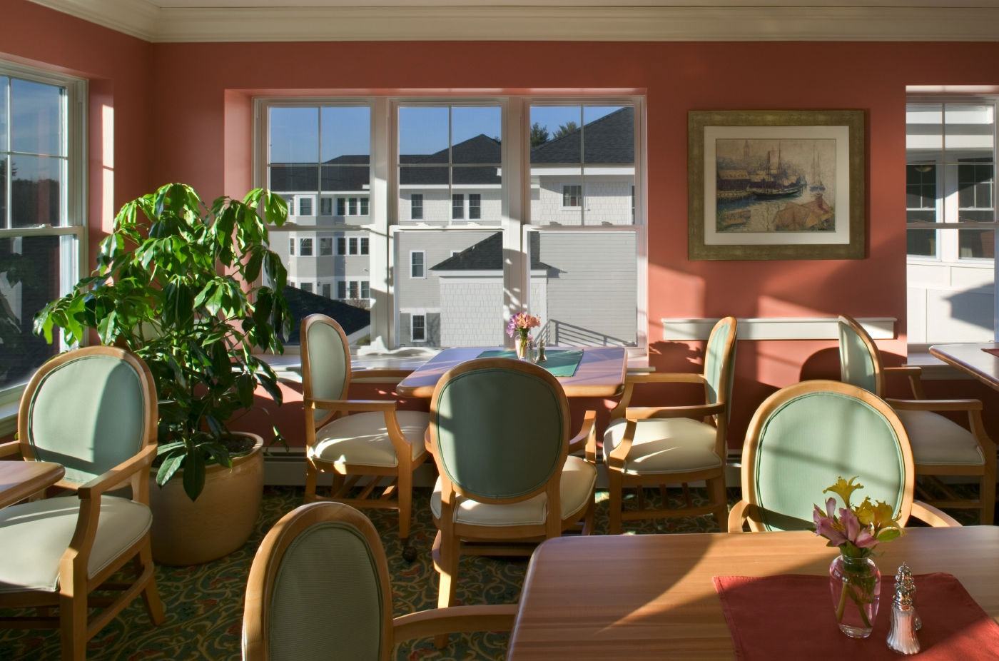 Sun-drenched dining area designed for seniors living in this NH CCRC