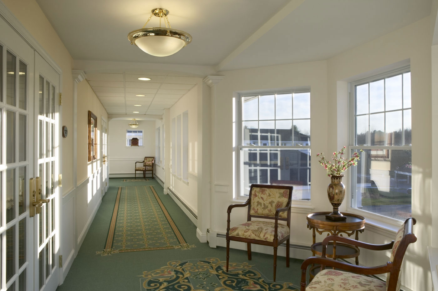 WDC interior designers created this bright and accessible hallway for a life plan community