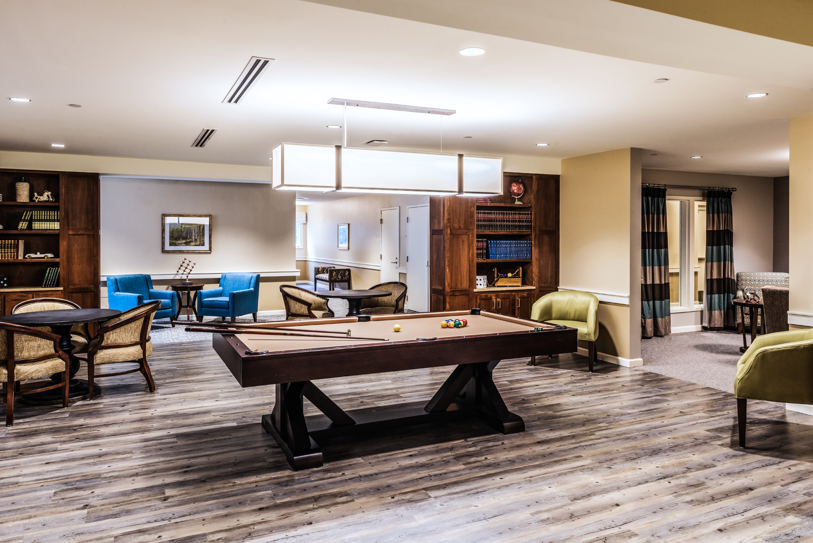 Engaging game room interior design for Massachusetts assisted living community.