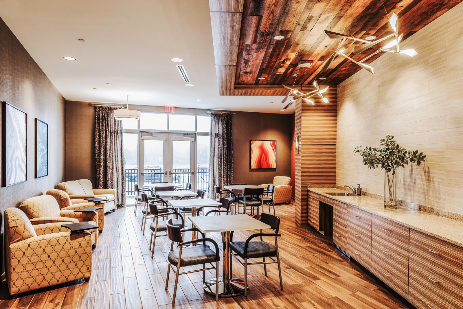Modern rustic cafe designed by WDC interior designers in assisted living  community